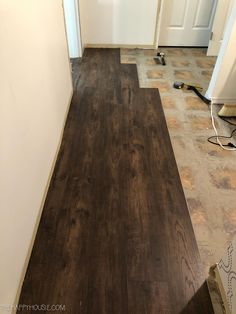 How to Install Vinyl Plank Over Tile Floors   The Happy Housie   LVP or Vinyl flooring is a great inexpensive flooring solution to update your home, but preparing the old substrate and floors is key to a smooth install. #flooring #laminate