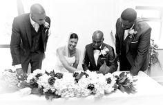 Signing the register bride & groom.Traditional wedding photography at Q Vardis Uxbridge, London.