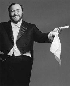 The extraordinary Italian tenor Luciano Pavarotti, whose white handkerchief was a performance trademark.