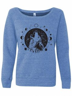Ignite your wild side in this howling wolf sweatshirt for Women. Featuring all the phases of the moon, this unique sweatshirt will remind you of nature and the stars on cozy days at home. Wrap a loved one in softness by sending them one this Holiday Season. #revivalink #wolfdesign #wolfdrawing #wolfandmoon #sweatersforwomen #printedsweaters #printedsweatshirts #womensweatshirt #fashionsweatshirt #sweatshirtart