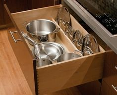 Account for lid storage. Having to store pot lids can be a nightmare. There are many ways to solve this problem, but my favorite is to create a divider in a pullout drawer