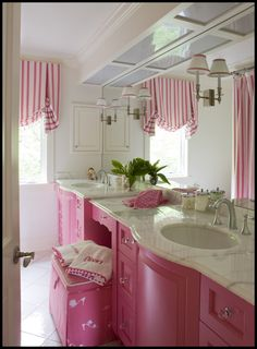 i love the curved cabinet and countertop. i also love pink and white. Mr. D does not. :o)