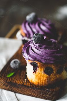 Blueberry cupcakes by The baking man on Creative Market