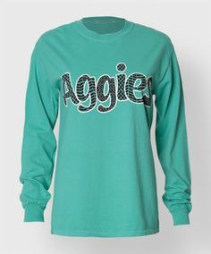 """This mint 100% cotton longsleeve shirt reads """"Aggies"""" on the front with a different pattern fills. The back has a block ATM with a maroon chevron fill and reads """"Gig 'em""""."""