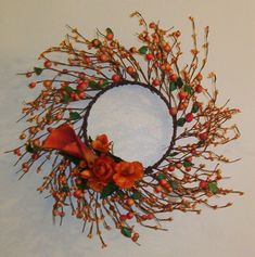 Fall berry wreath with Orange Calla lilies, ranunculus and altstromeria added,. http://www.dectouch.com