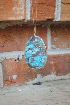 "This Natural, turquoise like stone, has marbling in brown and turquoise. Slightly faceted, free form pendant is 2.75"" x 2.5."" On a 24"" Gold Filled, delicate cable chain.  bricksandbaubles.com"
