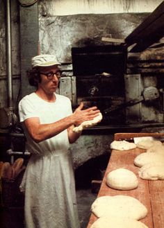 Woody Allen making pizza.  Allen was born Allan Stewart Konigsberg, in The Bronx, and raised in Brooklyn, New York...the son of Nettie (born Cherrie; November 8, 1906 – January 27, 2002), a bookkeeper at her family's delicatessen, and Martin Konigsberg (December 25, 1900 – January 13, 2001), a jewelry engraver and waiter.[9] His family was Ashkenazi Jewish; his grandparents immigrated from Russia and Austria, and spoke Yiddish, Hebrew, and German.[10