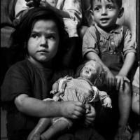 ITALY. 1948. Naples. A little girl with her battered doll, waiting for milk distribution at an ONMI (National Organization for the Protection of Children and Mothers).