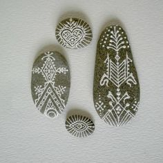 geometric painted pebbles by OurFolkLife on Etsy