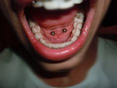 I had this piercing in high school... Took it out b/c it made it harder to sing...