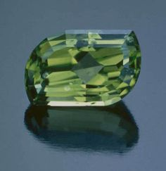 Faceted peridot (forsterite) from the deposit on the San Carlos Indian Reservation. Tino Hammid photo.