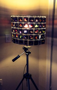 Re-purposes old camera tripod and slides into a fun floor lamp!