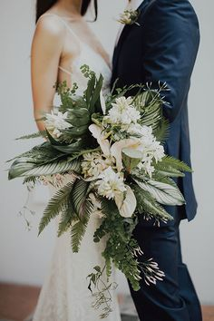 Loose, Natural Bouquet with Ferns and Flowers | Brides.com