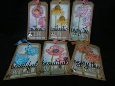 """My versions of Tim Holtz's 12 tags of 2015 - April.  I used all six of the """"Flower Garden"""" stamps to make a tag for each one.  Made by Theresa Petermann using Tim Holtz, Ranger, Idea-ology, Sizzix and Stamper's Anonymous products; Apr 2015"""