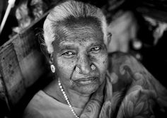 Old woman in Pondicherry, India by Eric Lafforgue
