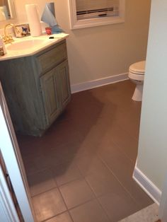 painted the powder room floor in Annie Sloan Chalk Paint Coco.  Thank you Annie Sloan!