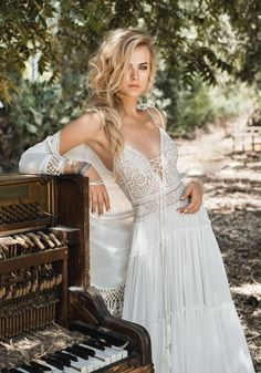 This boho wedding dress by Inbal Raviv definitely has something unique about it! Channeling a slightly hippie and ultra romantic gypsy style, the lace detailed bodice and flowy skirt just nail relaxed bridal style. See 10 bohemian wedding dresses brides will love for 2017 right here • Wedding Ideas magazine #weddingdress