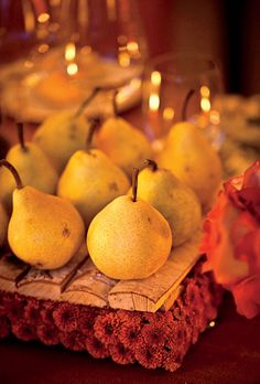 Rustic wedding centerpiece of pears and mums autumn