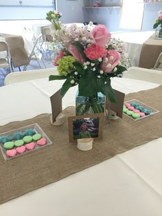 Graduation table flower centerpiece. Rustic and photo display with flowers in blue mason jar.                                                                                                                                                     More