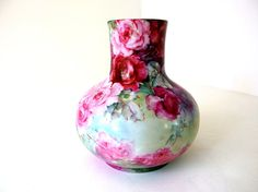 This beautiful, vintage hand painted vase is chock a block with roses - red and pink with soft hues of blue, purple and green. The Leonard of Vienna