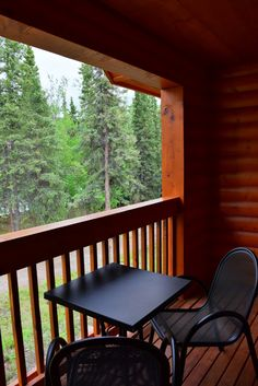 Balcony overlooking a spruce forest in Alaska. View from our room at Denali Park Village Lodge.