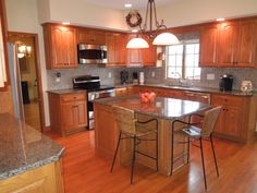 Updated kitchen with granite tops, center island, tile back splash & GE stainless appliances.