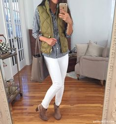 Olive puffer vest, blue gingham shirt, white skinny jeans and tan suede booties