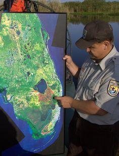 Ranger pointing out Lake Okeechobee on Florida map