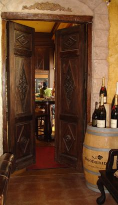 Beautiful pair of Mexican antique doors      installation in restaurant in Moorpark