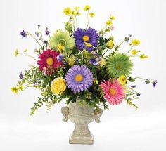 Bold, colorful daisies are the star of this arrangement.