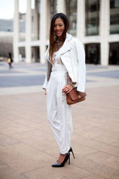 25 Winter White Outfits to Try - Blogger Aimee Song wearing a white leather jacket, matching trousers + black pointy heels and a brown leather crossbody bag