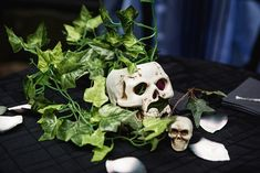 Skulls with greenery table centrepieces · Rock n Roll Bride Bride Reception Dresses, Ceremony Dresses, Wedding Reception Decorations, Corpse Bride Wedding, Satanic Rituals, Weird Dreams, Handfasting, Centrepieces, Pastel Goth
