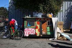 On a street in Oakland, Calif., a tiny home sits on wheels. The artist Gregory Kloehn, using recycle... - Jim Wilson/The New York Times