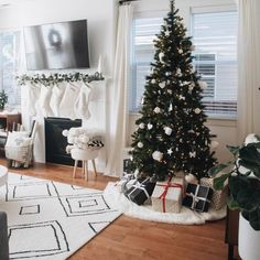 This hand-tufted rug is the ultimate on-trend statement with its Moroccan-inspired geometric pattern and clean edges. Christmas Tree And Fireplace, Christmas Tree With Presents, Christmas Living Rooms, Merry Little Christmas, Christmas Home, Christmas Tree Decorations, Christmas Trees, Xmas, Minimalist Christmas Tree