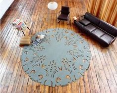 Cool Stylish And Colorful Nature-Inspired Rugs : Stylish And Colorful Nature Inspired Rugs With Blue Circle Rug With Unique Motif And Hardwood Floor Brown Chair Sofa Chandelier Pillow Magazine Polish Folk Art, Circle Rug, European Furniture, Italian Furniture, Modern Furniture, Carpet Design, Modern Rugs, Tool Design, Design Design