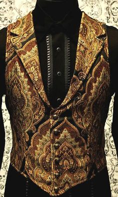 Victorian Aristocrat Vest A victorian gentleman's vest with class.  Great for formal occasions, can be worn under a suit jacket or by itself.  Made in rich gold/brown/green/black tapestry fabric with black satin lining and back. #goth #gothic #punk #punkrock #rockabilly #psychobilly #pinup #inked #alternative #alternativefashion #fashion #altstyle #altfashion #clothing #clothes #vintage #noir #infectiousthreads #horrorpunk #horror #steampunk #zombies #burningman #tattoos #shrine