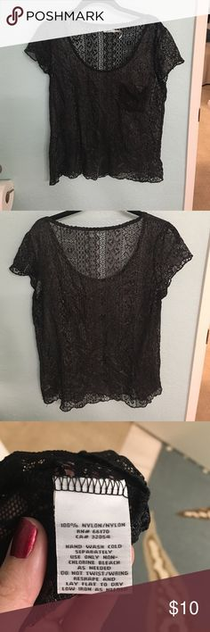 Black lace top Black lace top with pocket, with a metallic finish on front of shirt. Very cute and in good condition. Can be easily dressed or dressed down Kimchi Blue Tops Blouses