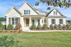 Frank Betz Summerlake Plan built by Horizon Custom Builders, Chapel Hill, NC Painted brick and cedar shake in BM Ballet White  and board and batten shutters painted in SW Porpoise create tons of curb appeal