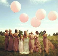Large balloons are also great for photos. If you're having flower girls they can take them as thank yous!