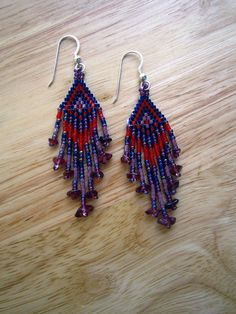 Our Berry Splash earrings are beaded in the peyote stitch, with a combination of Delica, vintage Czech beads, with stone chips of Garnet. They are hung on Sterling Silver earwires, and measure 3 inches from the top of the earwire, to the end of the longest dangle.  They were hand beaded by RC, ...