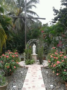 Virgin Mary and the Holy Cross in Casa Bethania. Santo Domingo, Dominican Republic. God has given to the sisters the amazing grace of having this gigant Cross on their garden, where God has made lots of mircales of healing, and liberating people that pray in front of it.