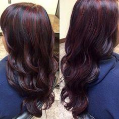 Deep red purple undertones on dark hair