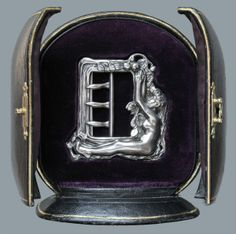 EDOUARD–AIME ARNOULD 'Eve' Symbolist Buckle  Silver H: 6.7 cm (2.64 in)  W: 6.4 cm (2.52 in)  Marks: 'AA' with a thistle & eagle's head French, c.1900