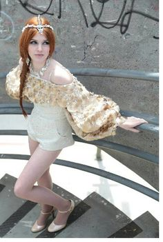 Kenzie Kilroy Los Angeles Model and Actress is modeling outfit designed and made by Julieta Kleven. Gold and pearl outfit made resembles a princess accompanied by a tiara.