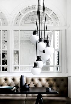 Mirror, Hanging Bulbs chandelier, Tufted Sofa