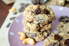 Oatmeal Cashew Chocolate Chunk Cookies -- Soft and chewy oatmeal cookies, packed with chocolate chunks and cashews. Easy to make, tough to resist!