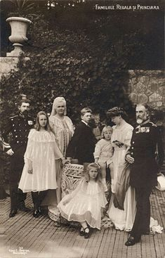 Another family portrait. Crown Prince Ferdinand, Princess Elisabeth, Queen Elisabeth, Prince Carol, Prince Nicholas, Crown Princess Marie, and King Carol I.