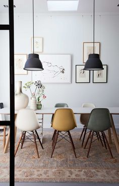 Dining space with colorful Eames chairs.