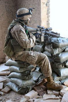 2/5 Marine stands watch in Ramadi, Iraq in February 2005