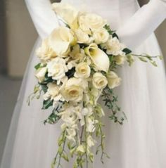 Cascade bouquet has a great shape using calla lilies and orchids, and perhaps ranunculus, and some garden or standard roses to fill in space.